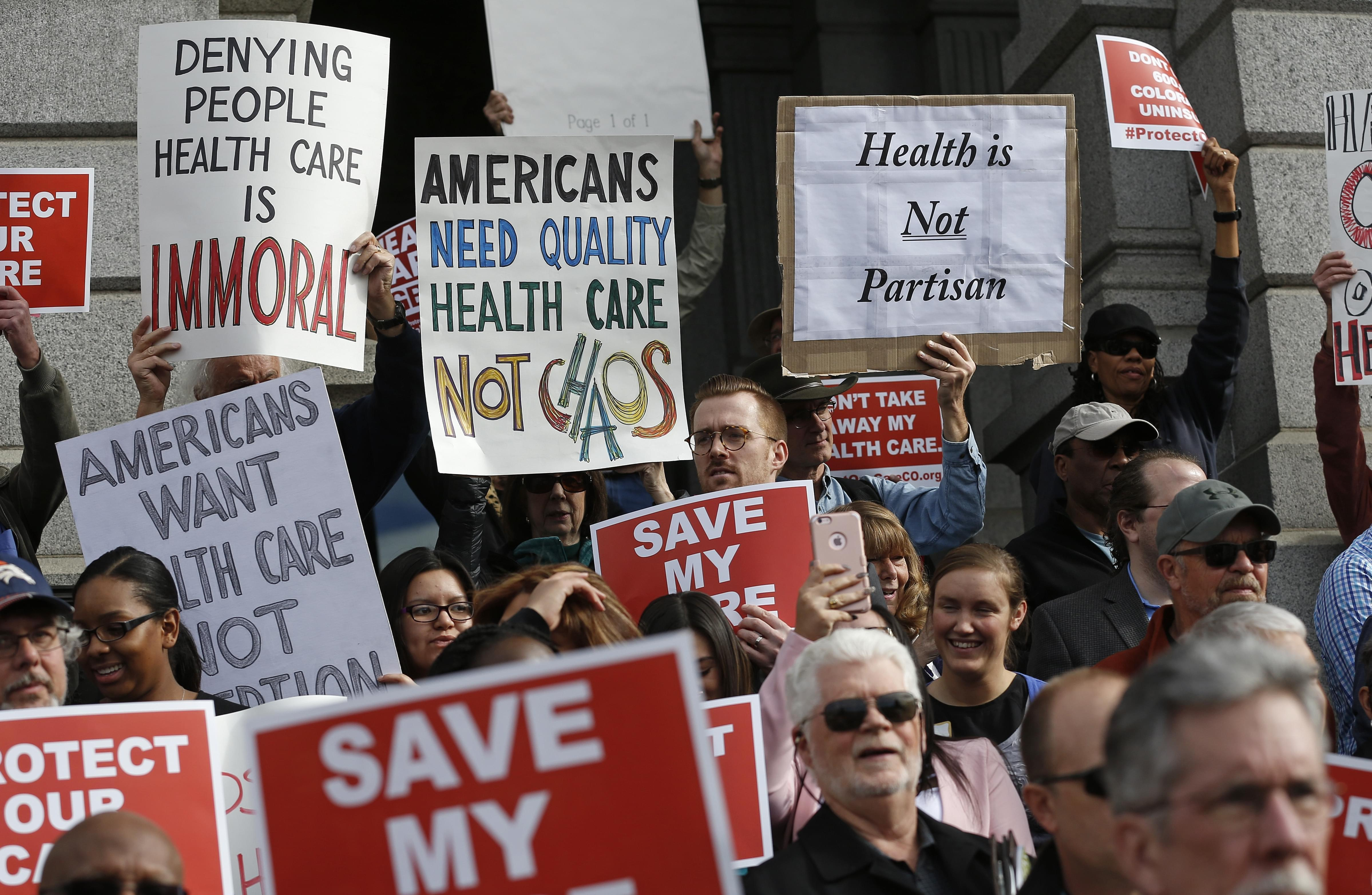 Supporters of the Affordable Care Act, who are also opponents of Colorado's GOP-led plan to undo Colorado's state-run insurance exchange, gather for a rally on the state Capitol steps in Denver, Tuesday, Jan. 31, 2017.