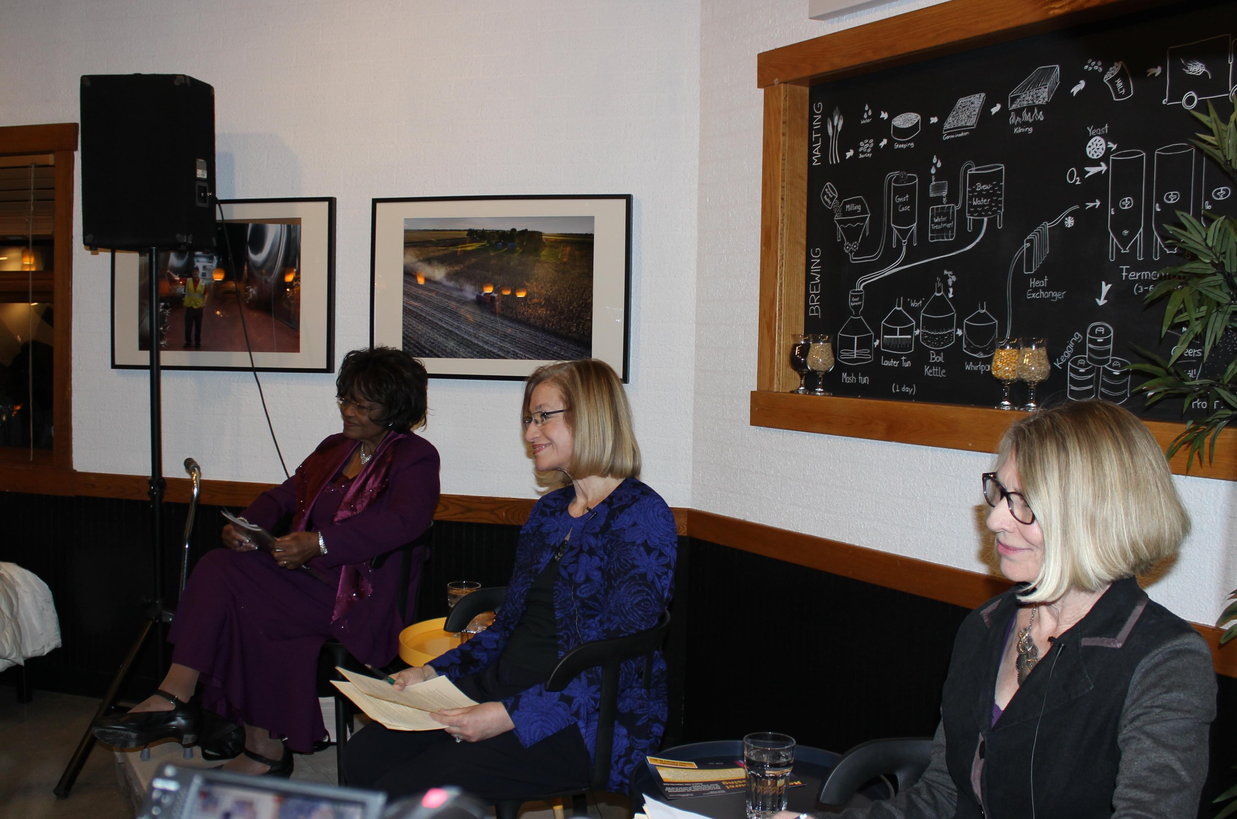 Rev. Evelyn Burnett Underwood, Incument Mayor Laurel Prussing, and Alderwoman Diane Marlin debated at Urbana's Riggs Brewery Wednesday.