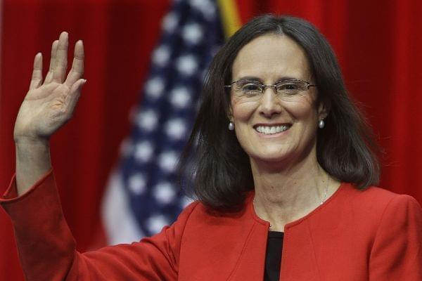 Illinois Attorney General Lisa Madigan makes her entrance before taking the oath of office as Illinois' Attorney General Monday, Jan. 12, 2015, in Springfield Ill.