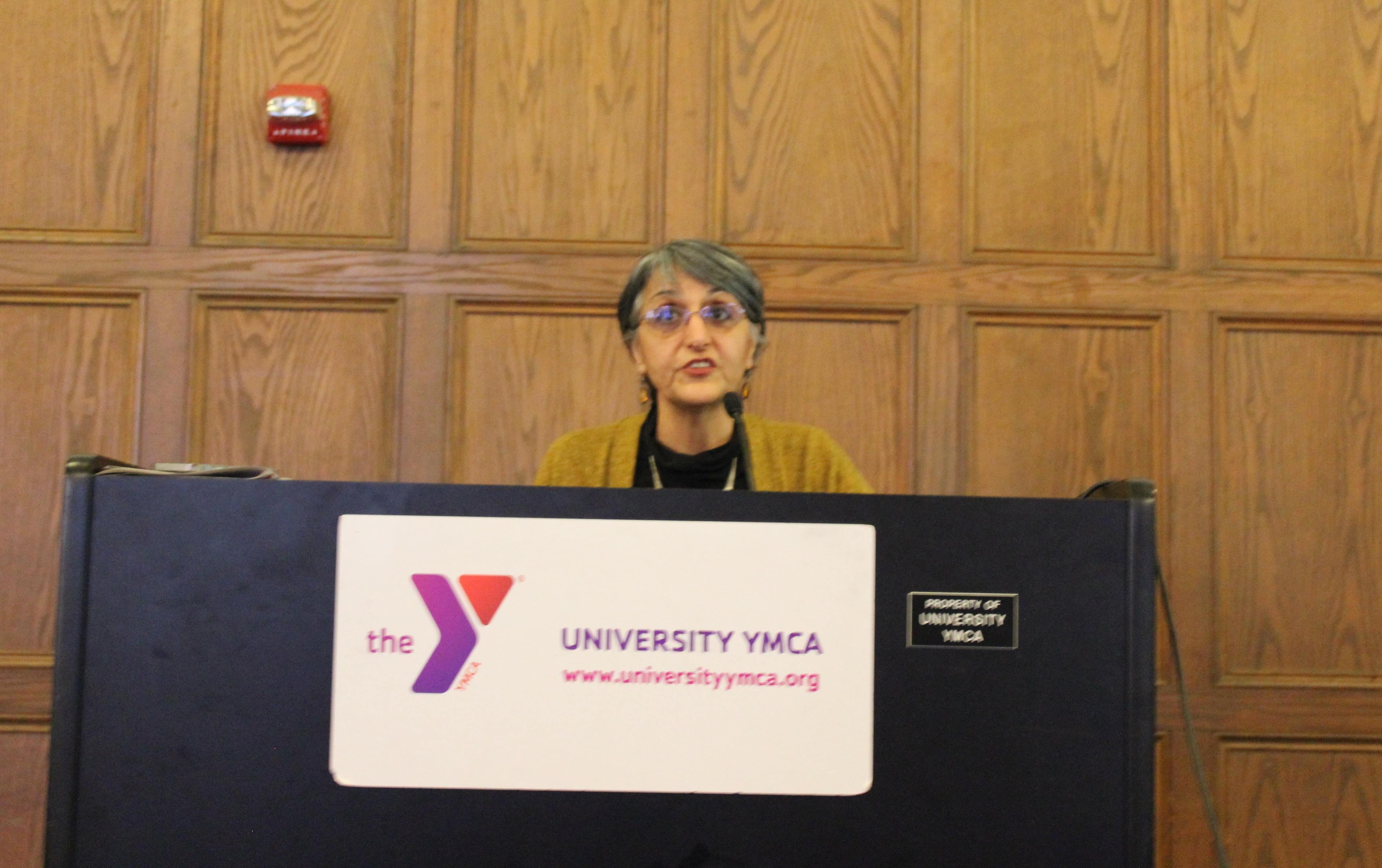 U of I Urban and Regional Planning Professor Faranak Miraftab discusses her research of Beardstown at the University YMCA Friday.