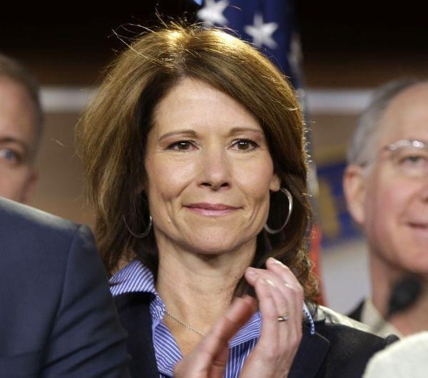 Rep.-elect Cheri Bustos D-Ill. is seen on stage during a news conference with newly elected Democratic House members, on Capitol Hill in Washington, Tuesday, Nov. 13, 2012.