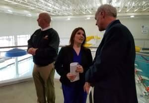 Lt. Gov. Evelyn Sanguinetti talks to Urbana Park District Executive Director Tim Bartlett during a stop at the Urbana Indoor Aquatic Center on Tuesday