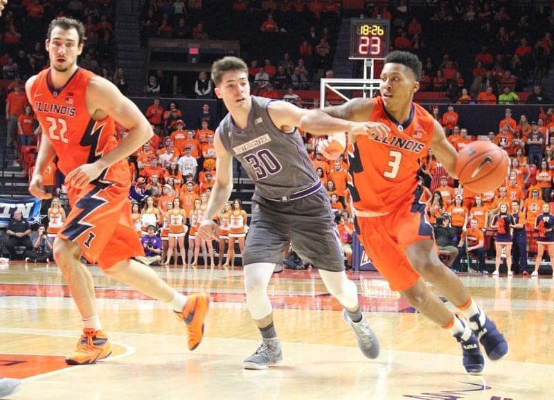 Illini Te'jon Lucas (3) dribbles past Northwestern's Bryant McIntosh (30) Tuesday night in Champaign.