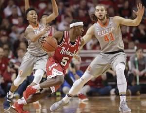 Nebraska's Glynn Watson Jr. (5) drives around Illinois' Te'Jon Lucas, left, and Michael Finke (43) during the first half of an NCAA college basketball game in Lincoln, Neb., Sunday, Feb. 26, 2017.