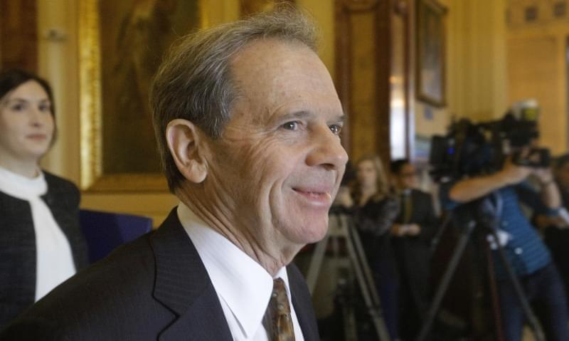 Illinois Senate President John Cullerton, D-Chicago, walks into Illinois Gov. Bruce Rauner's office during veto session at the Illinois State Capitol Wednesday, Nov. 30, 2016, in Springfield.