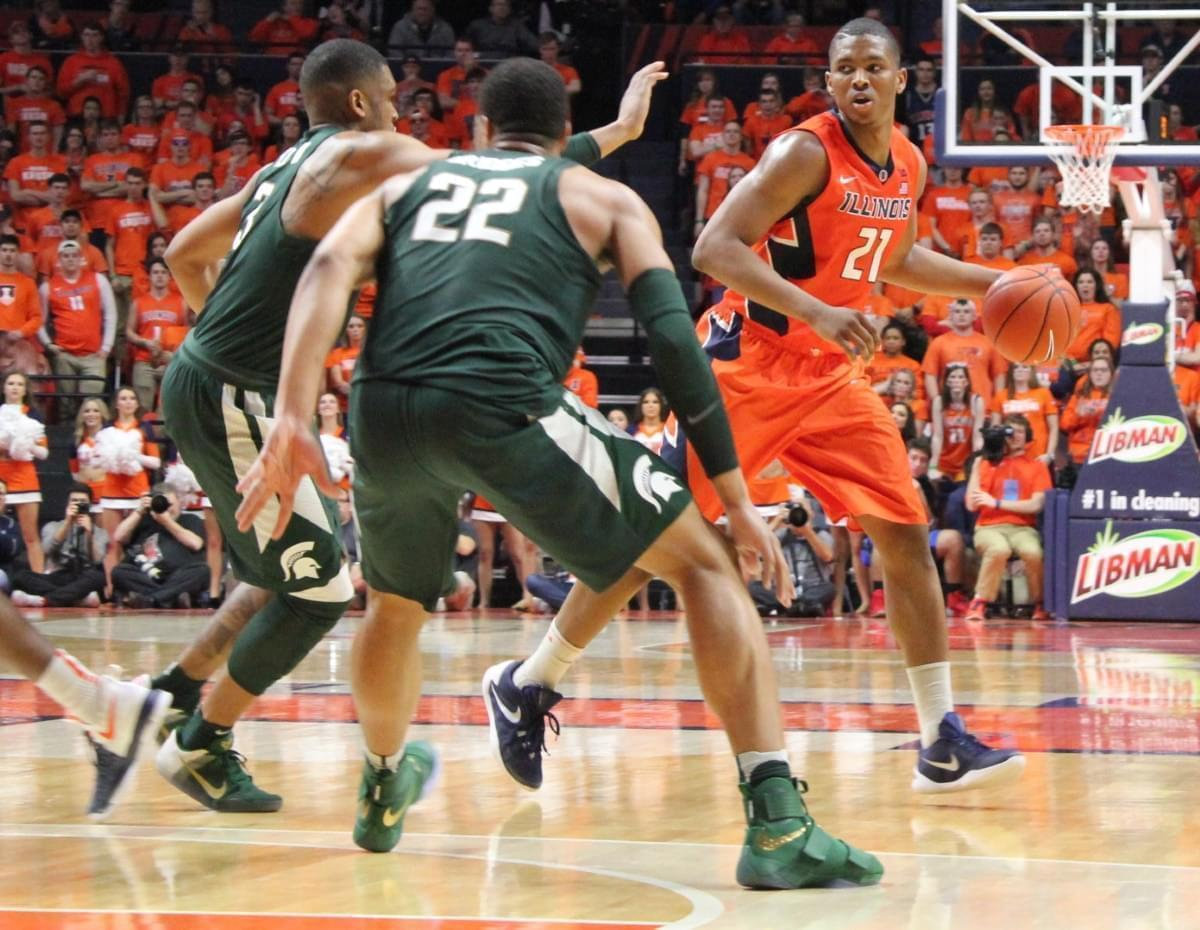 Illini Malcolm Hill dribbles past a double team of Alvin Ellis III & Miles Bridges (22)