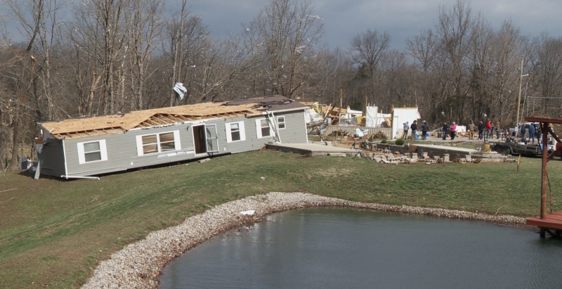 Wreckage of a house moved off of its foundation by a tornado in rural Jackson County.