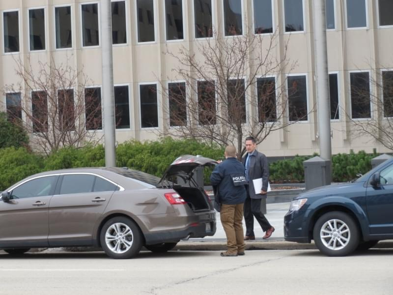 """At least a dozen cars and several dozen agents were visible along Adams Street during the late morning and early afternoon hours."" -WCBU"