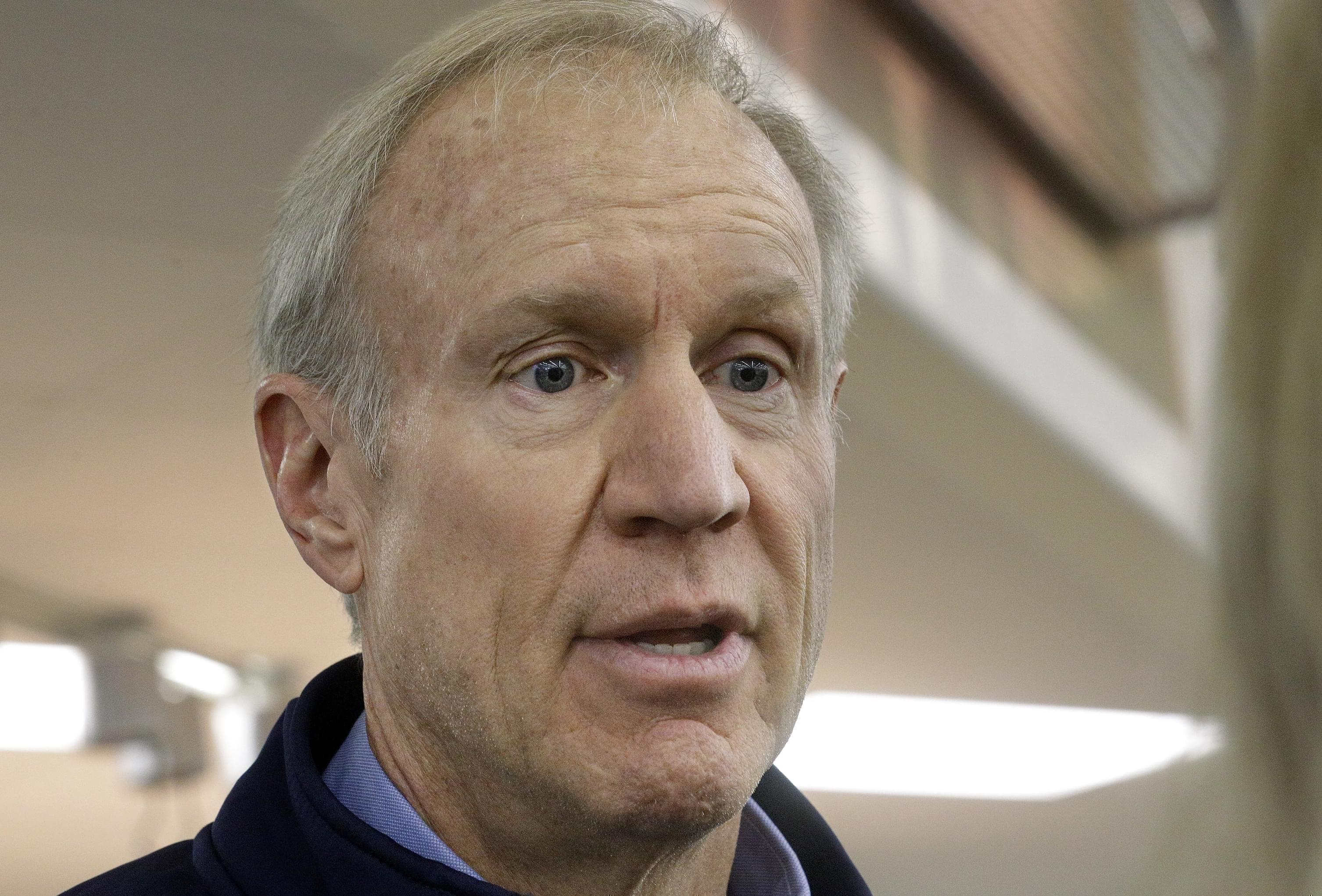 """Illinois Gov. Bruce Rauner speaks to reporters after greeting veteran and participating in """"Breakfast to Veterans for Veterans Day"""" Friday, Nov. 11, 2016, in Springfield."""