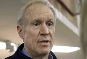 "Illinois Gov. Bruce Rauner speaks to reporters after greeting veteran and participating in ""Breakfast to Veterans for Veterans Day"" Friday, Nov. 11, 2016, in Springfield."