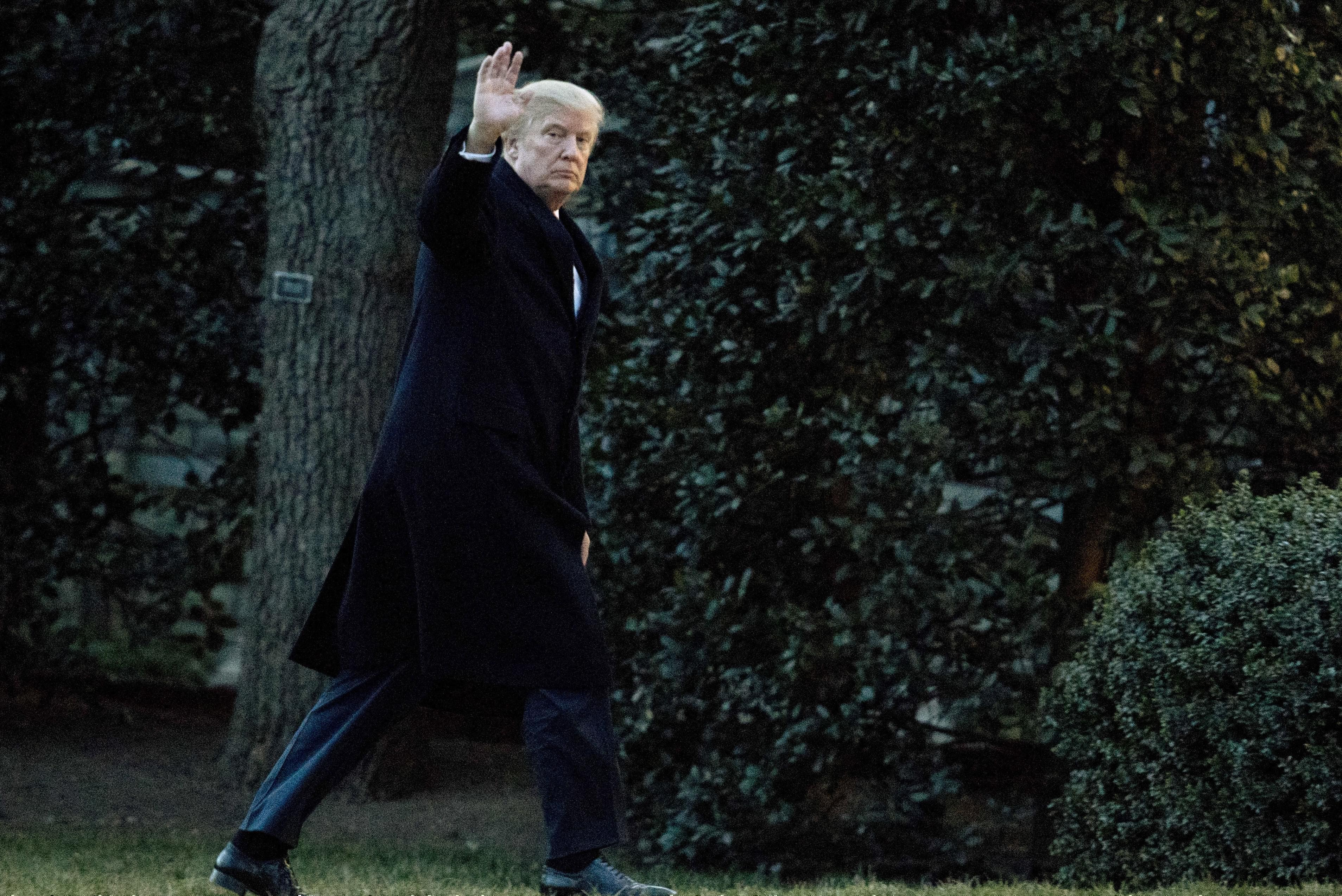 President Donald Trump waves as he arrives at the White House in Washington, Sunday, March 5, 2017, from a trip to Florida.