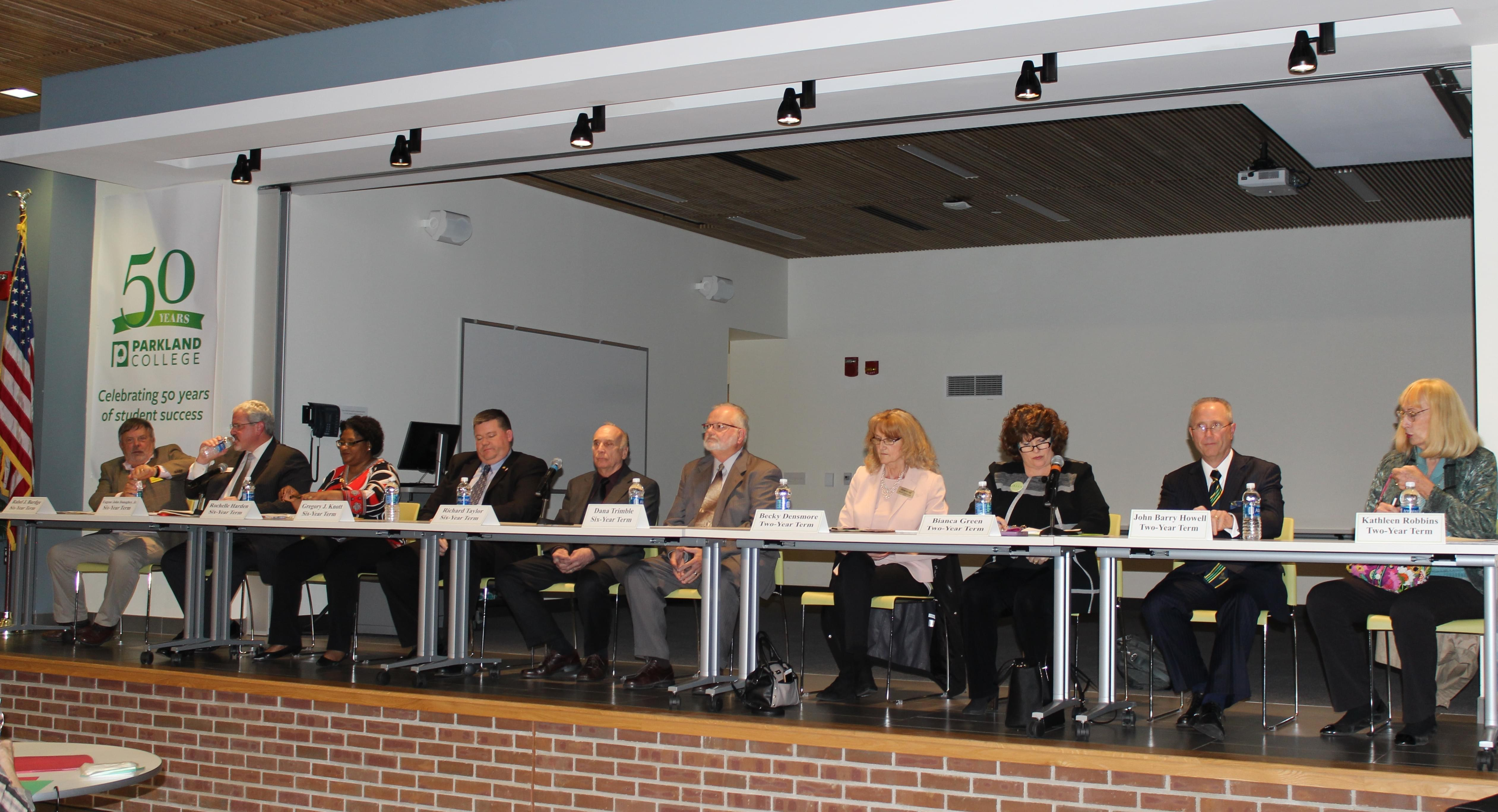 Candidates for Parkland College's Board of Trustees gather in the Student Union cafeteria for Monday's debate.