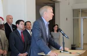 Gov. Bruce Rauner is joined by Republican Senators at Middletown Prairie Elementary School in Mahomet on June 1, 2016.