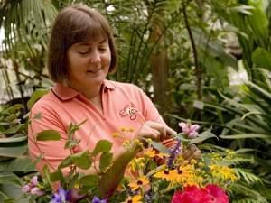 Dianne Noland, host of Mid-American Gardener examining a plant