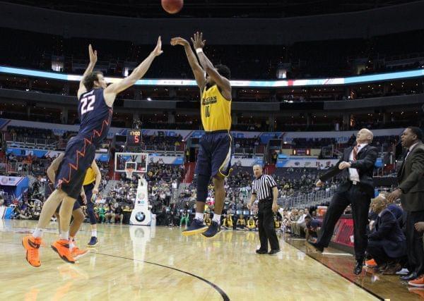 Derrick Walton shooting over Maverick Morgan in a Big Ten tournament basketball game.