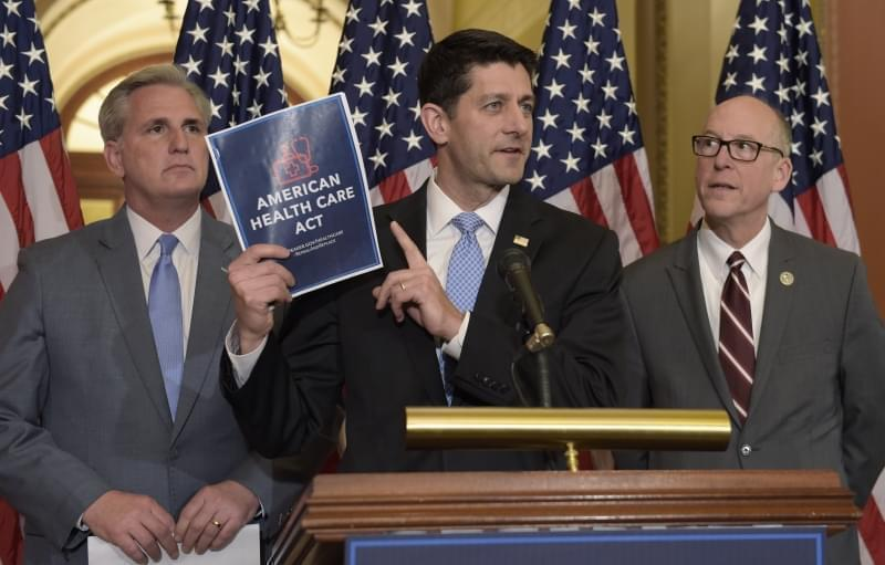 House Speaker Paul Ryan of Wis., center, standing with Energy and Commerce Committee Chairman Greg Walden, R-Ore., right, and House Majority Whip Kevin McCarthy, R-Calif., left, speaks during a news conference on the American Health Care Act on Capit