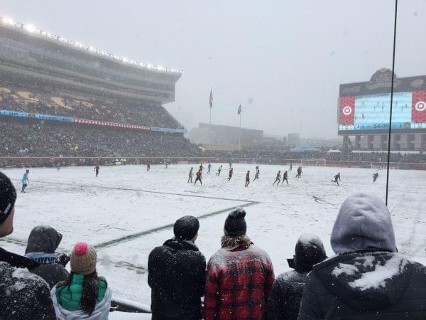 A snowy soccer field