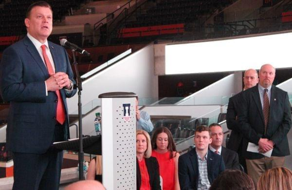 New Illinois basketball coach Brad Underwood addresses the media, while his family and Illini athletic staff look on.