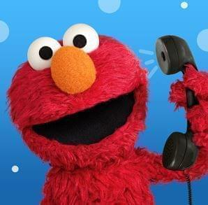 Elmo character talking on telephone.