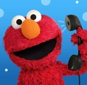 Elmo character talking on telephone.
