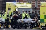 "Emergency services transport an injured person to an ambulance, close to the Houses of Parliament in London, Wednesday, March 22, 2017. London police say they are treating a gun and knife incident at Britain's Parliament ""as a terrorist inc"