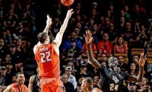 Centers Maverick Morgan with the Illini and Tacko Fall of UCF compete for the ball during their Wednesday night NIT quarterfinal game in Orlando.