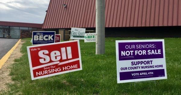 Signs promoting the two referenda regarding the Champaign County Nursing Home.