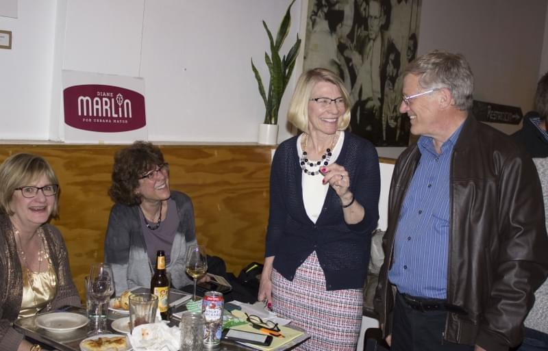 Diane Marlin celebrates her victory with supporters at Pizza M in Urbana.