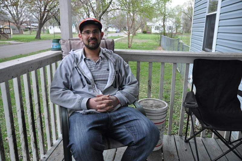 Sam Werkmeister, 30, sits on his porch in Granite City.