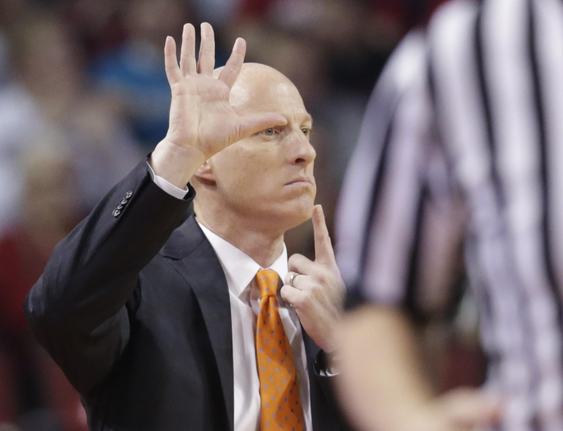 Former Illinois coach John Groce signals a play during the first half of an NCAA college basketball game against Nebraska in Lincoln, Neb., Sunday, Feb. 26.