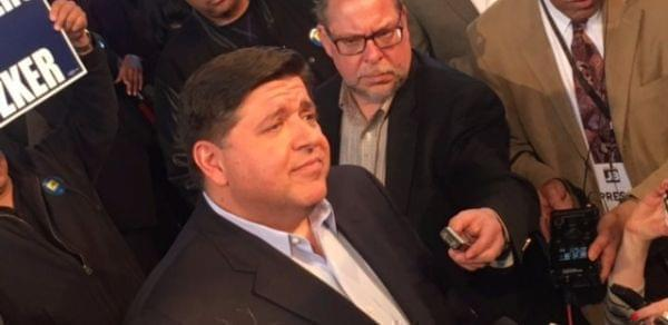 J.B. Pritzker talks with reporters