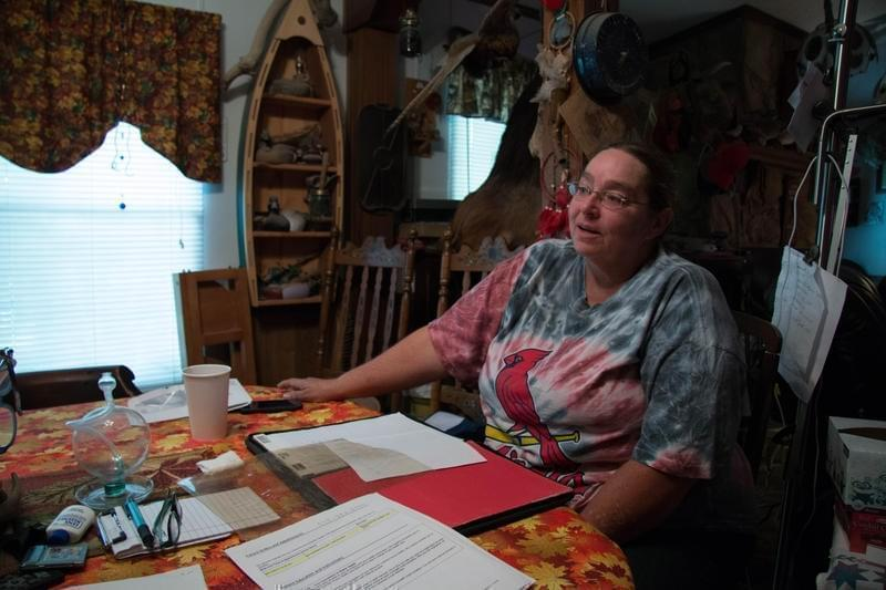 Corla Morgan sitting at her sister's dining room table in Higbee, Mo.
