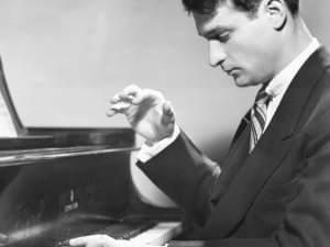 Photo of pianist William Kapell playing the piano