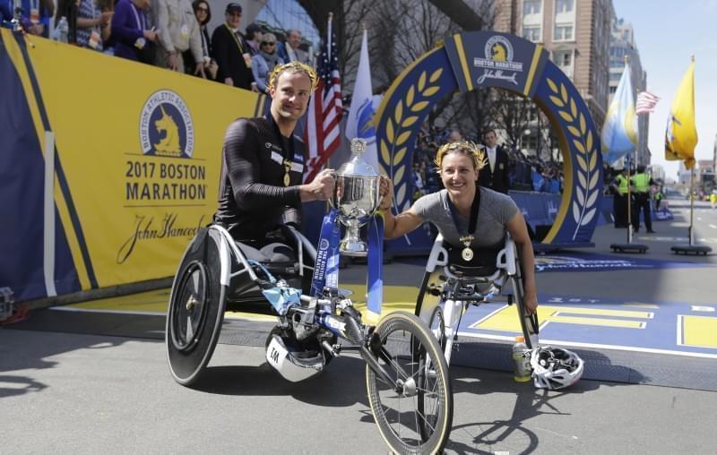 Boston Marathon wheelchair division winners Manuela Schar and Marcel Hug, both of Switzerland.