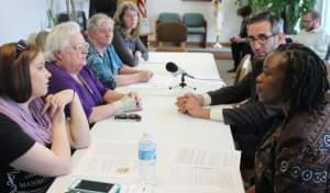 State Rep. Carol Ammons and Rep. Will Guzzardi are joined by a panel of home health care workers