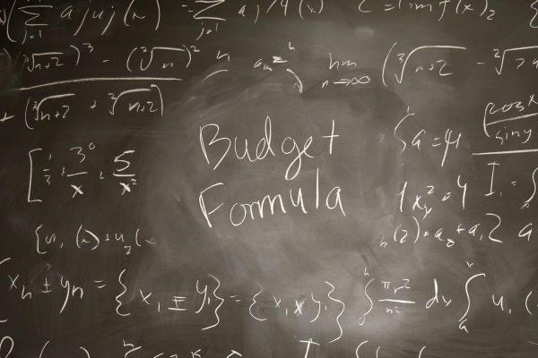 Formulas on a chalkboard.