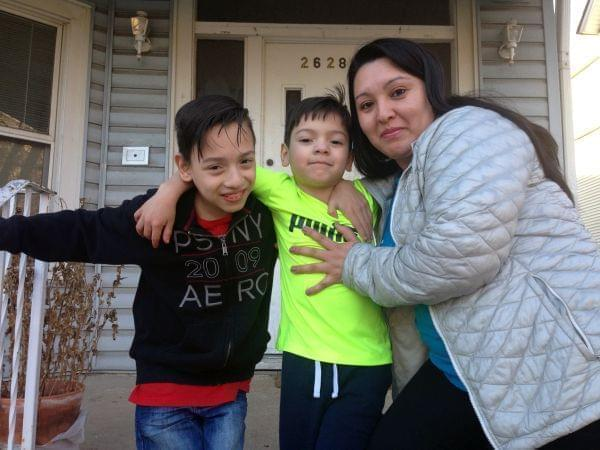 Gabriela Baraja, right, and her sons Melvin Garcia, left, and Antonio Garcia pose for a photo at their home in Chicago on Wednesday, Feb. 22, 2017. As President Donald Trump moves ahead with a nationwide immigration crackdown, school principals in Ch