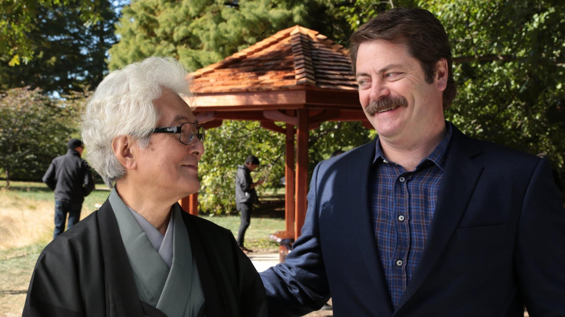 Actor Nick Offerman (right) stands with mentor and U of I professor emeritus Shozo Sato in front of a gazebo the Offerman helped to build for Japan House on the Urbana campus.