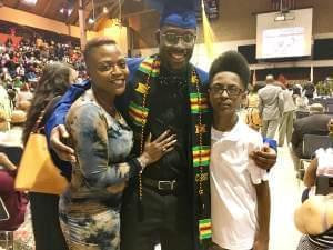 Dashawn Julion poses with his mother, Leisha Julion, and his 13-year-old brother Larry at the Black Congratulatory ceremony.