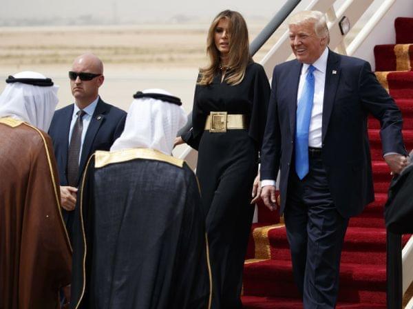 President Donald Trump, accompanied by first lady Melania Trump, smiles at Saudi King Salman, upon his arrival in Riyadh, Saudi Arabia.
