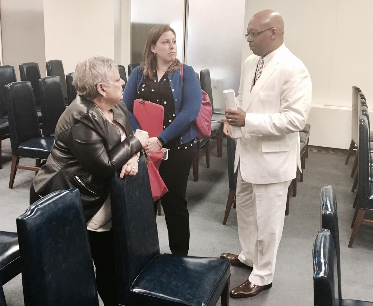 Rep. Will Davis (D-Homewood) chats with advocates representing suburban school districts Wednesday.