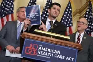 Speaker of the House Paul Ryan holds up a copy of the American Health Care Act during a March 7 news conference with House Majority Leader Kevin McCarthy, R-Calif. (left), and House Energy and Commerce Committee Chairman Greg Walden, R-Ore., outside