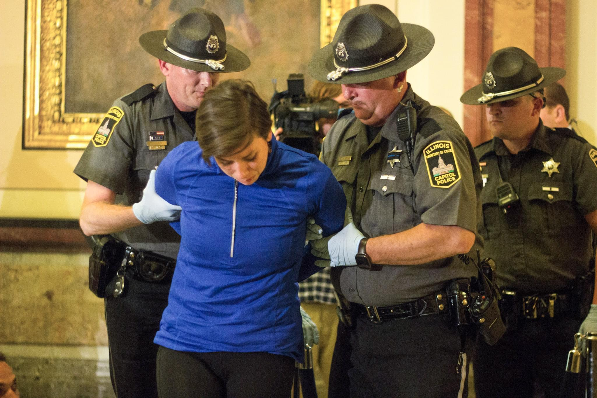 A protester being arrested at the Illinois state capitol on Tuesday evening