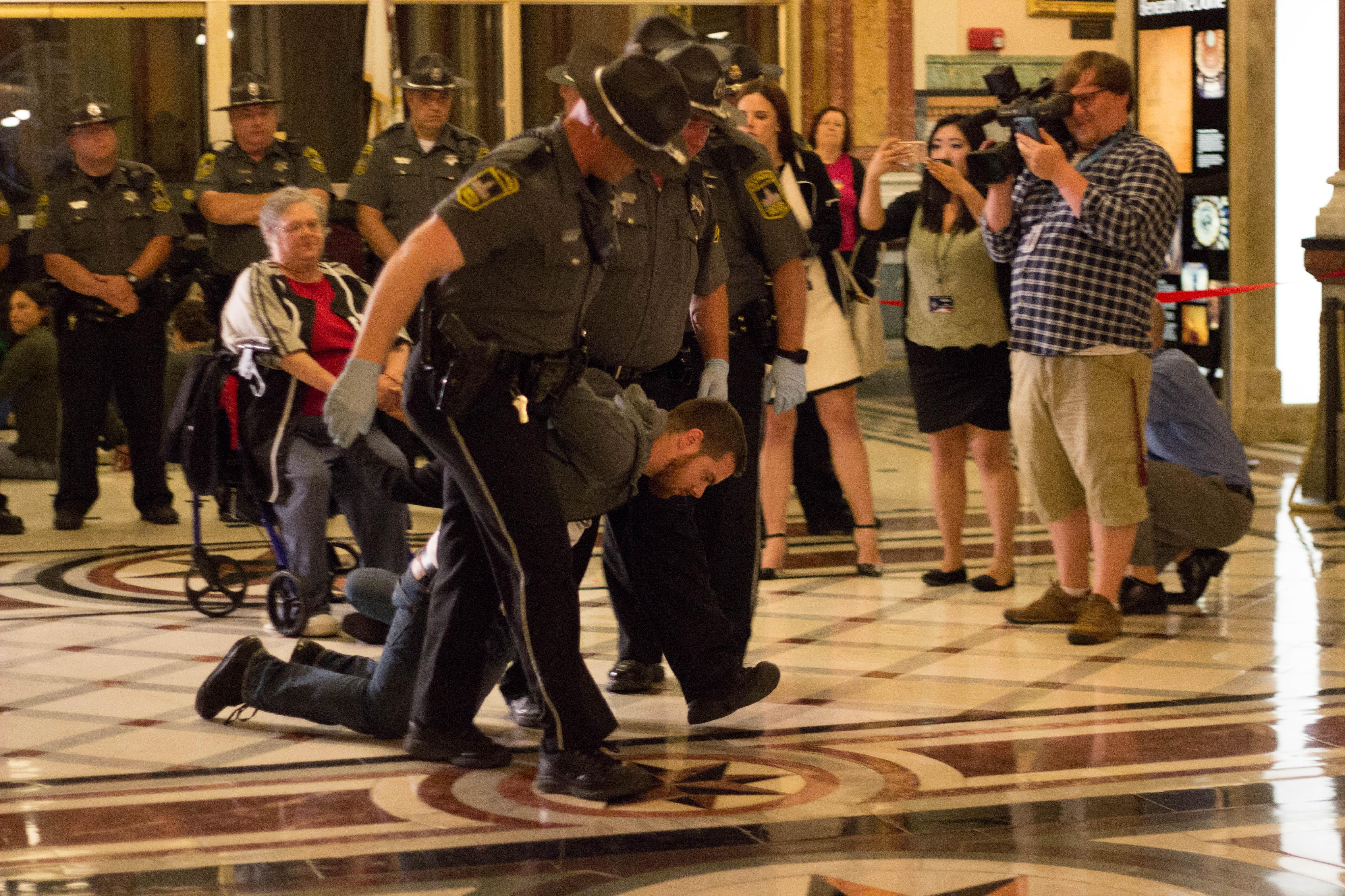 Nearly three-dozen activists were arrested during a sit-in Tuesday night at the Illinois State Capitol.