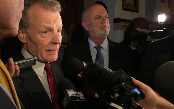 House Speaker Michael Madigan, left, speaks with reporters on Wednesday.