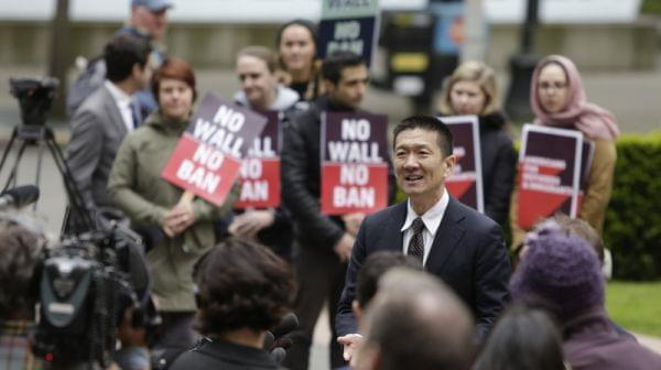 Hawaii Attorney General Doug Chin speaks to media outside the 9th Circuit U.S. Court of Appeals in Seattle, Washington, on May 15, 2017. The court has largely upheld a preliminary injunction blocking President Trump's travel ban from going into