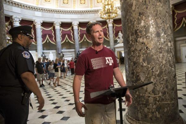 Rep. Rodney Davis, R-Ill., still wearing his baseball uniform, describes the scene on Capitol Hill in Washington, Wednesday.