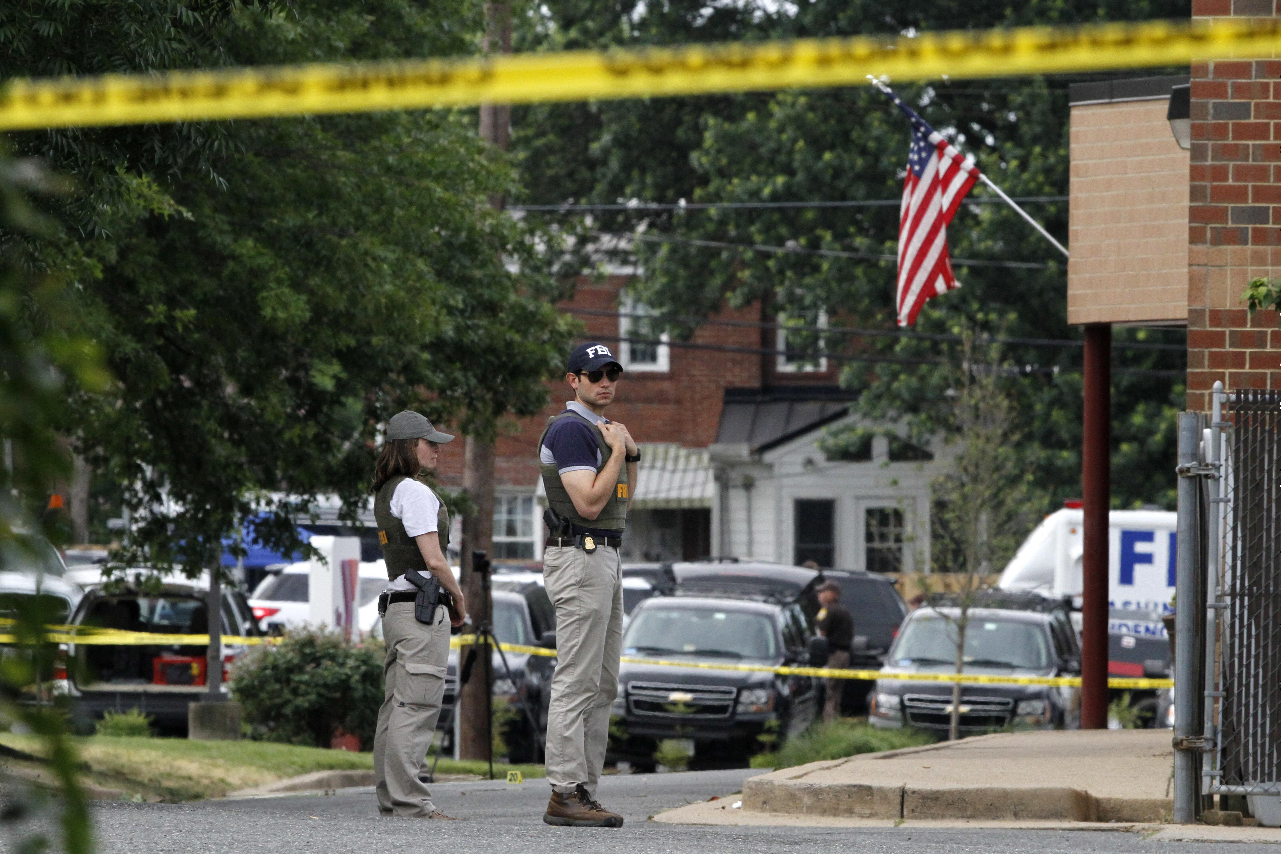 FBI agents at the scene of Wednesday's shooting at a Congressional Republican baseball practice in Alexandria, Va.