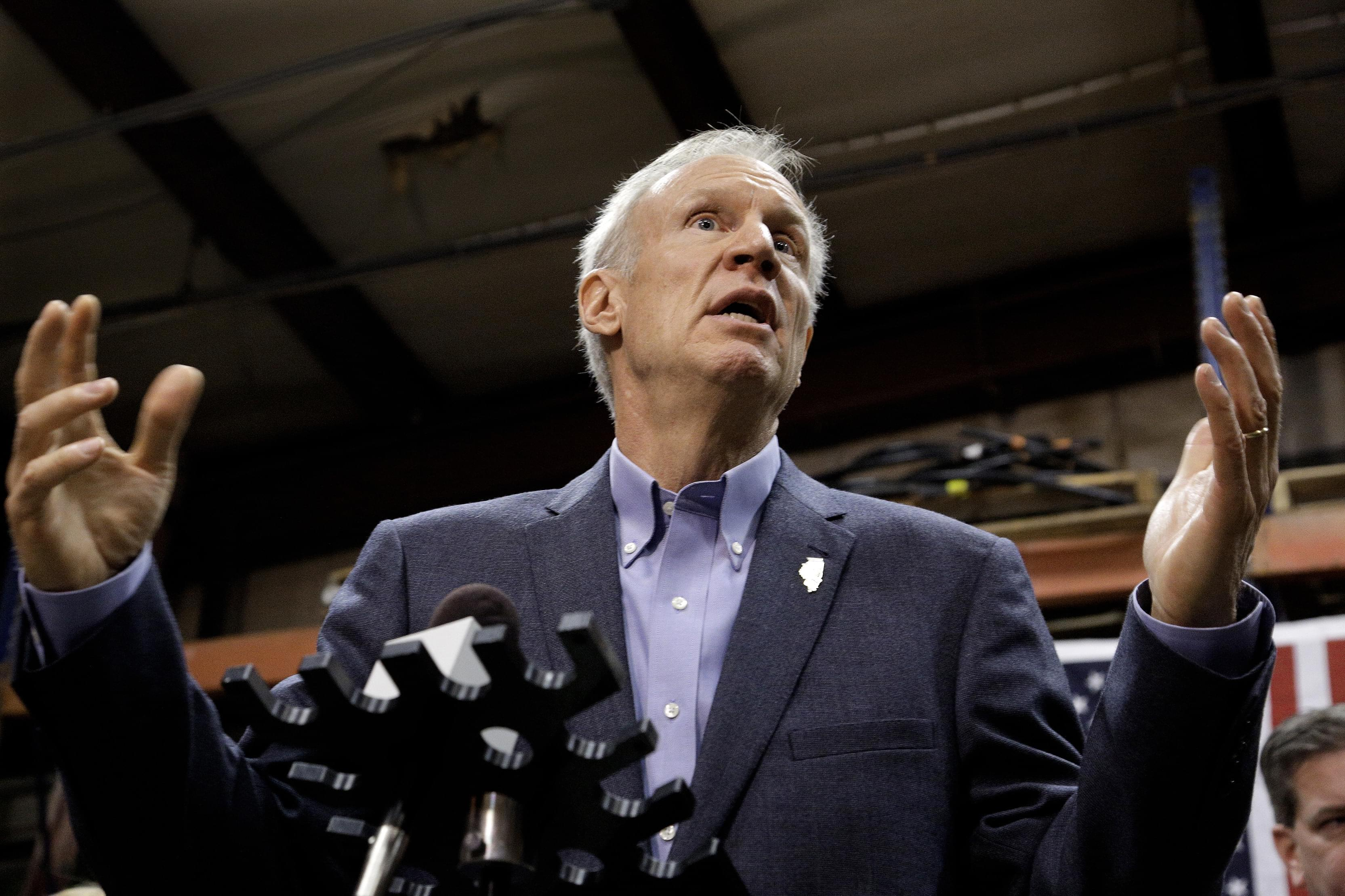 In this Wednesday, Nov. 16, 2016 photo, Illinois Gov. Bruce Rauner speaks to reporters after meeting with legislative leaders during veto session in Springfield, Ill.