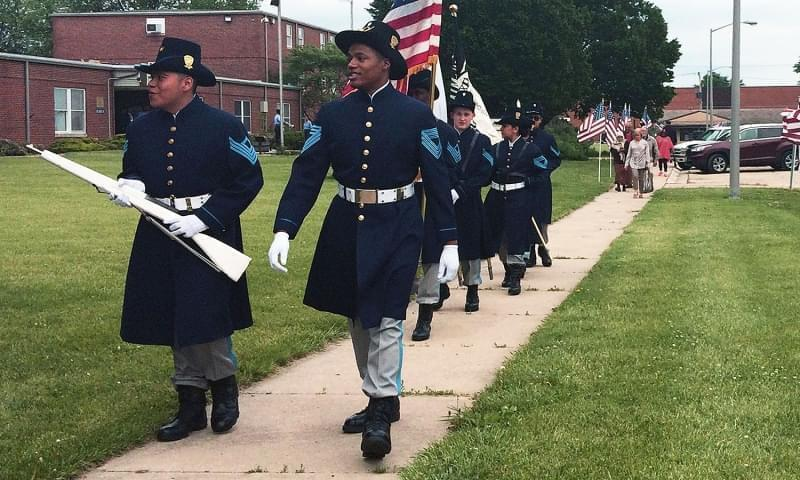 Lincoln's Challenge Academy cadets prepare for a Memorial Day ceremony last month at the school in Rantoul. The start of the next class will be delayed due to the state budget impasse.